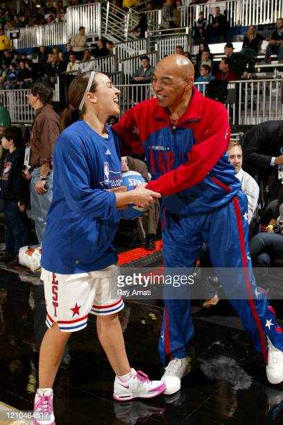 Becky Hammon of the San Antonio Silver Stars shares a laugh with Harlem Globetrotters legend Fred Curly Neal during the 2010 NBA AllStar Celebrity...