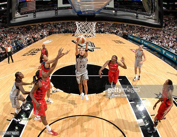 Becky Hammon of the San Antonio Silver Stars shoots against Nicky Anosike and Monique Currie of the Washington Mystics at the ATT Center on September...