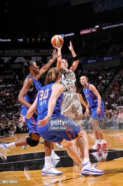Becky Hammon of the San Antonio Silver Stars shoots against Taj McWilliamsFranklin of the Detroit Shock in Game Two of the WNBA Finals on October 3...