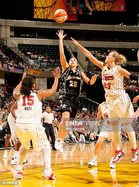Becky Hammon of the San Antonio Silver Stars shoots over Katie Douglas and Tan White of the Indiana Fever at Conseco Fieldhouse on June 15 2008 in...