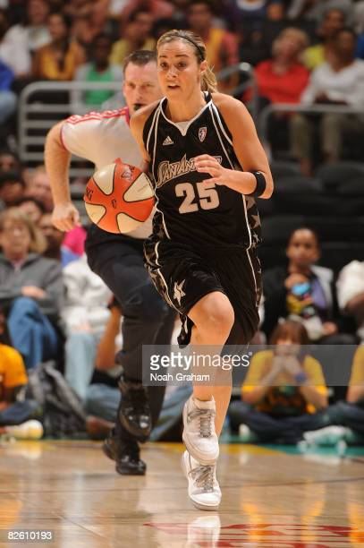 Becky Hammon of the San Antonio Stars drives the ball against the Los Angeles Sparks during the game at Staples Center on August 30 2008 in Los...