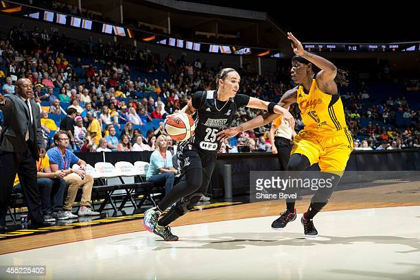 Becky Hammon of the San Antonio Stars drives to the basket against Roneeka Hodges of the Tulsa Shock during the WNBA game on August 8 2014 at the BOK...