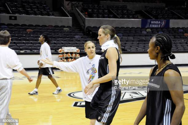 Becky Hammon speaks to Erin Buescher of the San Antonio Silver Stars at practice during media availability after Game One of the WNBA Finals on...