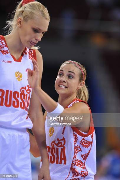 Becky Hammon talks to Irina Osipova of Russia against Brazil during day 4 of the women's preliminary basketball game at the 2008 Beijing Olympic...