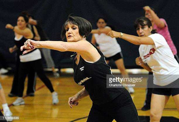 Becky Hopkins center participates in a Zumba class at the Simmons YMCA in Charlotte North Carolina April 23 2010 Zumba is a high energy Latin dance...