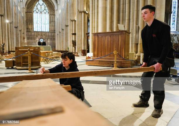 Becky Johnson a joiner with York Minster's Works Department prepares a wooden cross as it is suspended from York Minster's Central Tower as part of...