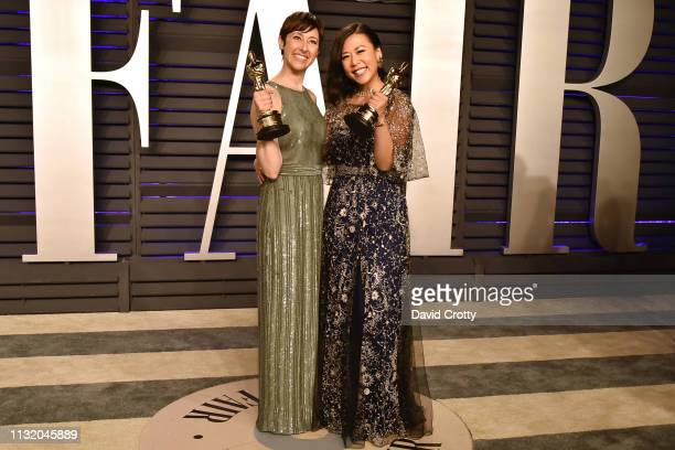 Becky NeimanCobb and Domee Shi attend the 2019 Vanity Fair Oscar Party at Wallis Annenberg Center for the Performing Arts on February 24 2019 in...