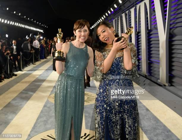 Becky NeimanCobb and Domee Shi pose with the Academy Award for Best Animated Short Film during the 2019 Vanity Fair Oscar Party hosted by Radhika...
