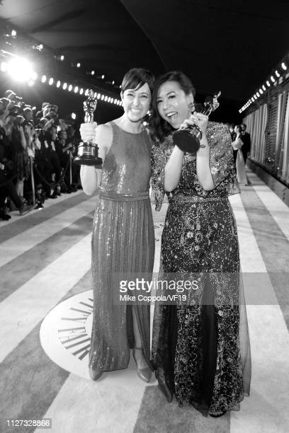 Becky Neiman-Cobb and Domee Shi pose with the Academy Award for Best Animated Short Film during the 2019 Vanity Fair Oscar Party hosted by Radhika...