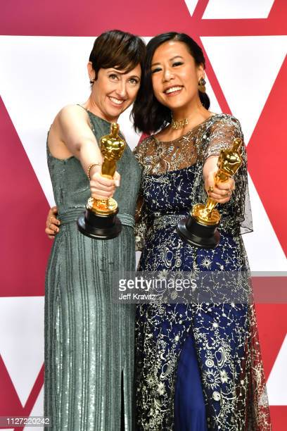 Becky NeimanCobb and Domee Shi pose with the Best Animated Short Film award for Bao in the press room during at Hollywood and Highland on February 24...