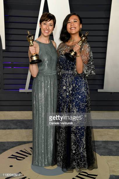 Becky NeimanCobb and Domee Shi pose with the Best Animated Short Film award for 'Bao' during 2019 Vanity Fair Oscar Party Hosted By Radhika Jones...