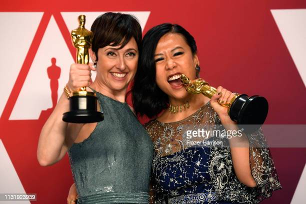 Becky NeimanCobb and Domee Shi winners of Best Animated Short Film for Bao pose in the press room during the 91st Annual Academy Awards at Hollywood...