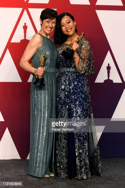 """Becky Neiman-Cobb and Domee Shi, winners of Best Animated Short Film for """"Bao,"""" pose in the press room during the 91st Annual Academy Awards at..."""