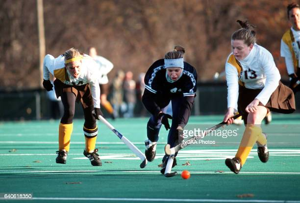 Becky Peterson and Kelly Rose of Rowan University defend against Amber Fulginiti of Messiah College during the Division III Women's Field Hockey...