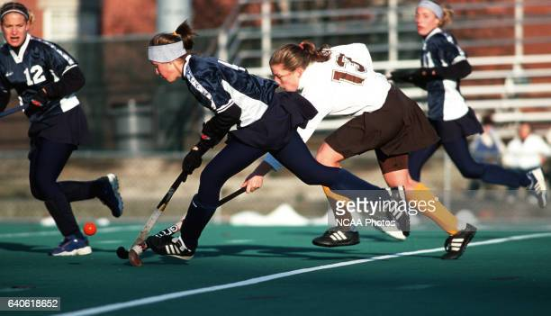 Becky Peterson of Rowan University tries to slow down Amber Fulginiti of Messiah College during the Division III Women's Field Hockey Championship...