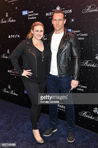 Becky Poliakoff and actor Andrey Ivchenko attend Le Casino night hosted by Brooks Brothers in Beverly Hills to benefit UCLA Jonsson Cancer Center...