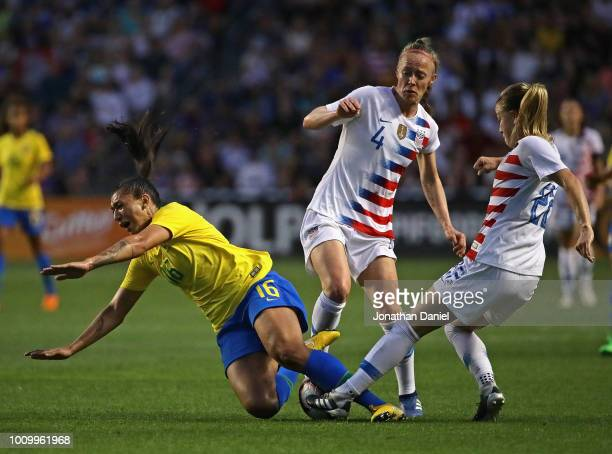 Becky Sauerbrunn and Emily Sonnett of the United States take down Beatriz of Brazil during the 2018 Tournament Of Nations at Toyota Park on August 2...