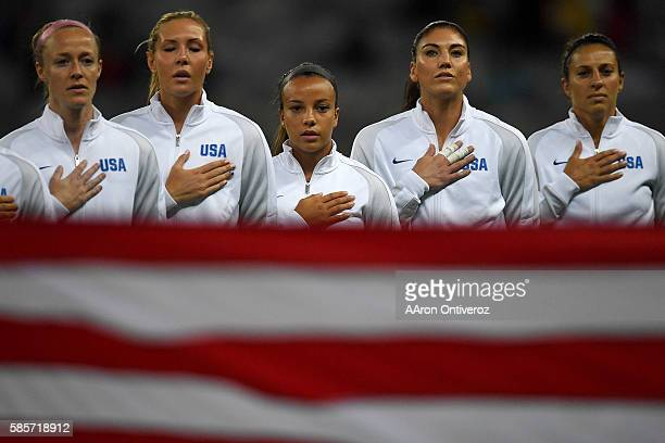 Becky Sauerbrunn of the United States Allie Long Mallory Pugh Hope Solo and Carlie Lloyd stand for their country's national anthem before the first...