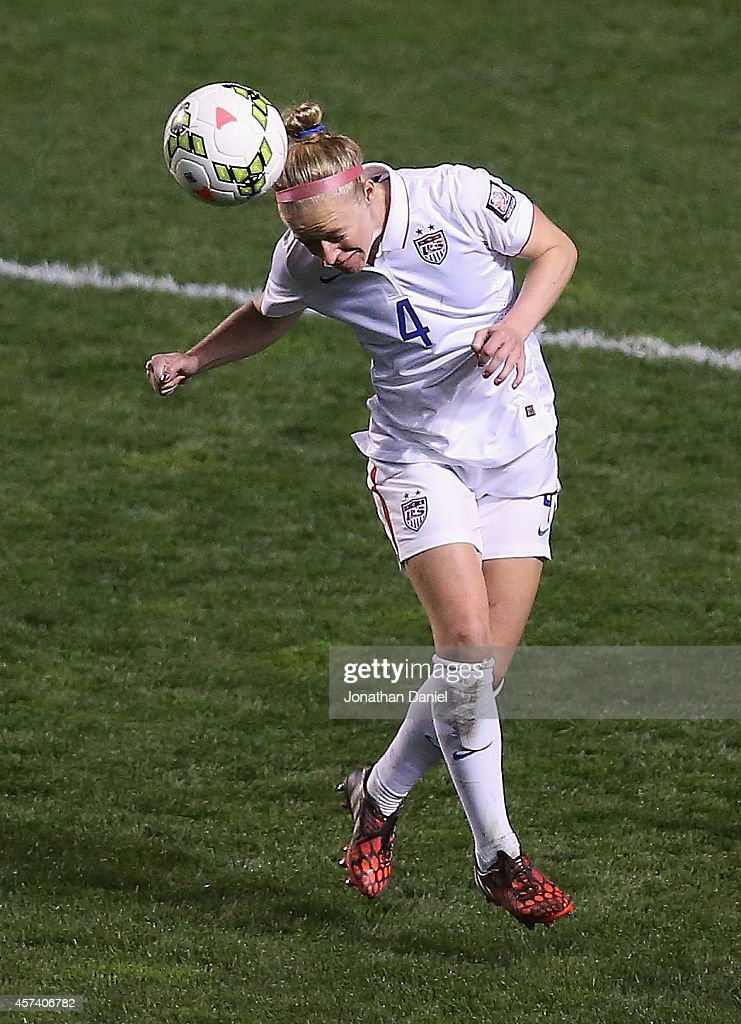 Becky Sauerbrunn #4 of the United States heads the ball against Guatemala during the 2014 CONCACAF Women's Championship at Toyota Park on October 17, 2014 in Bridgeview, Illinois. The United States defeated Guatemala 5-0.