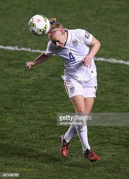 Becky Sauerbrunn of the United States heads the ball against Guatemala during the 2014 CONCACAF Women's Championship at Toyota Park on October 17...