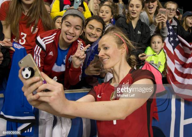 Becky Sauerbrunn of the United States of America takes a selfie with fans after the match against Germany during the SheBelieves Cup at Talen Energy...