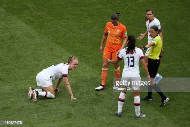 Becky Sauerbrunn of the USA goes down injured during the 2019 FIFA Women's World Cup France Final match between The United States of America and The...