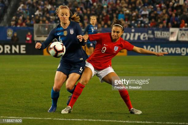 Becky Sauerbrunn of the USA plays against Jodie Taylor of England the 2019 SheBelieves Cup match between USA and England at Nissan Stadium on March 2...