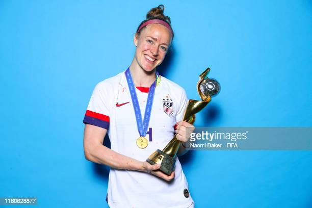 Becky Sauerbrunn of the USA poses with the Women's World Cup trophy after the 2019 FIFA Women's World Cup France Final match between The United State...