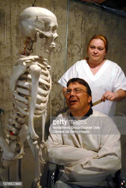 Becky Shadlich as nurse Plimpton above tries to get Dan Marquardt as Mark Styler out of a straight jacket while talking to a skeleton during...