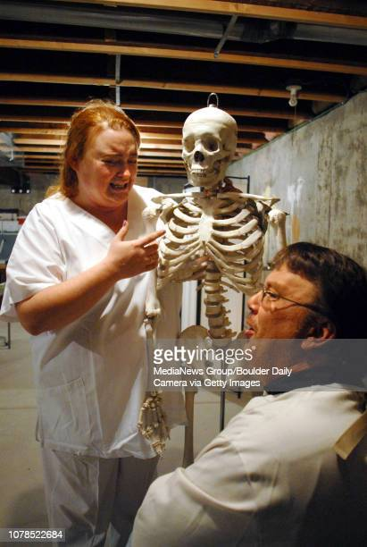 Becky Shadlich as nurse Plimpton left explains to Dan Marquardt as Mark Styler that the skeleton was a doctor during rehearsal of the Mind Game play...