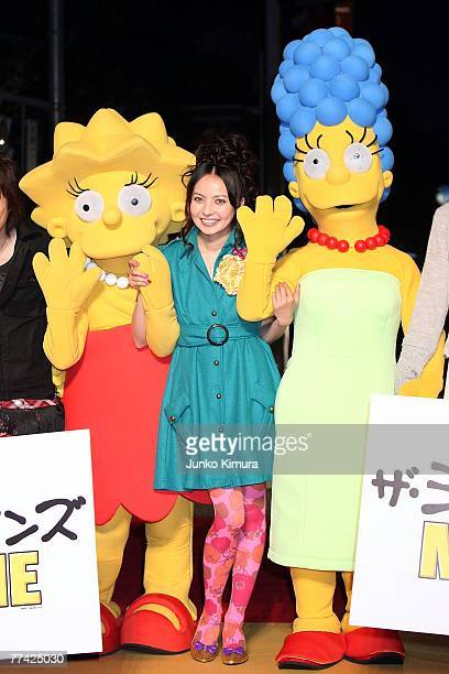 Becky walks on the red carpet with Simpsons characters during day one of the 20th Tokyo International Film Festival at Roppongi Hills on October 20...
