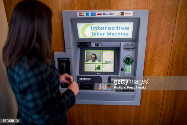Becky Winslow director or retail delivery for Gorham Savings Bank demonstrates to the Portland Press Herald how the bank's new Interactive Teller...