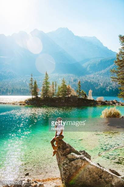 becoming one with nature at lake eibsee, germany – digital detox - oberbayern stock-fotos und bilder