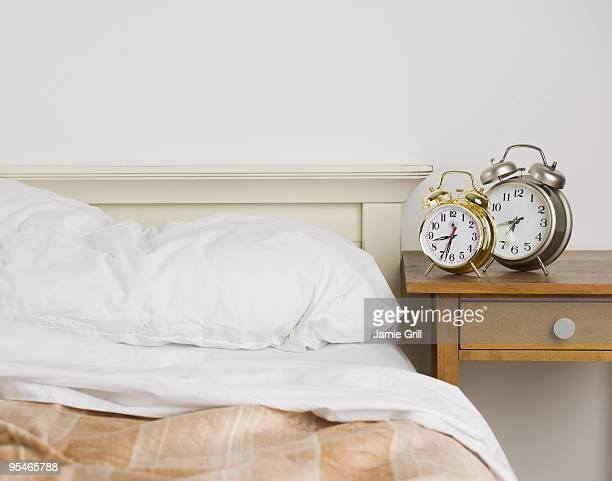 Bed and alarm clocks