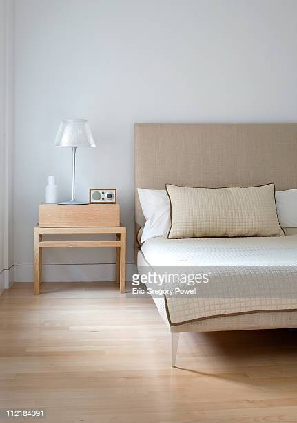 bed and nightstand, hardwood floor