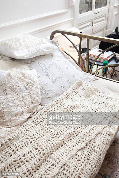 Bed covered with crocheted blanket
