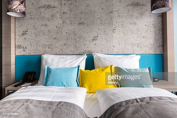 Bed in hotel room with colorful pillows