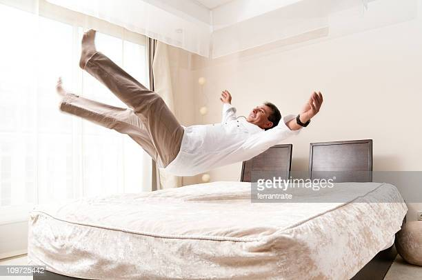 bed jump - mid air stock pictures, royalty-free photos & images