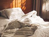 Bed Mattress Pillows Duvet unmade Bedroom Morning with sunlight Bedroom interior