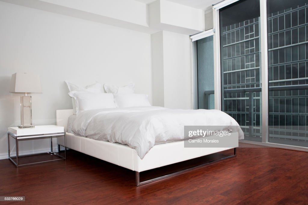 Bed, night table and closet in modern bedroom : Foto stock