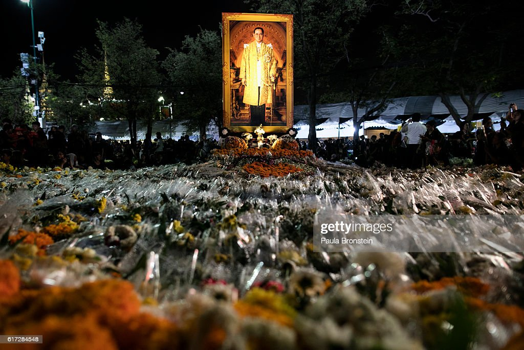 A bed of flowers from mourners is seen by a portrait of the late King on October 22, 2016 in Bangkok, Thailand. Tens of thousands attended the emotional event singing the Royal anthem which was filmed as a tribute to Thailand's King Bhumibol Adulyadej, the world's longest-reigning monarch, died at the age of 88 after his 70-year reign. The Crown Prince Maha Vajiralongkorn had asked for time to grieve the loss of his father before becoming the next king as nation waits for the coronation date.