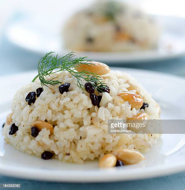 Bed of rice pilaf on a white plate topped with parsley