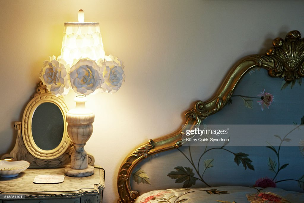 Bed room, illuminated night light and table : Stock Photo