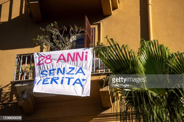 A bed sheet reading '28 years without the truth' is displayed outside a balcony to commemorate the 28th anniversary of the Capaci Massacre on May 23...