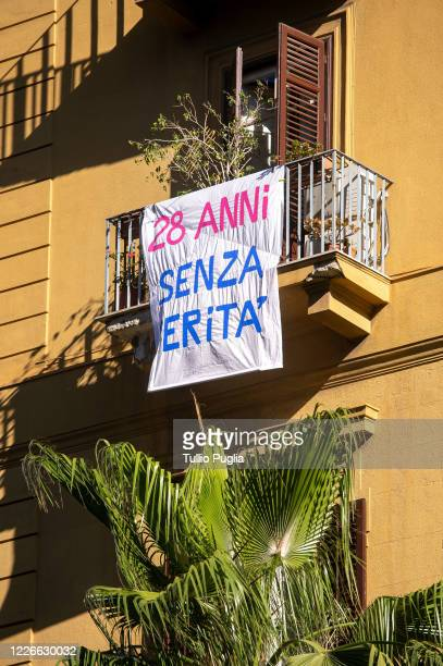 Bed sheet reading '28 years without the truth' is displayed outside a balcony to commemorate the 28th anniversary of the Capaci Massacre on May 23,...