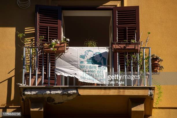Bed sheet showing image of judges Giovanni Falcone and Paolo Borsellino reading 'you did not kill them, their ideas will walk on our legs' is...