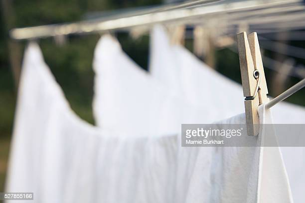 bed sheets drying on clotheslines - clothespin stock pictures, royalty-free photos & images