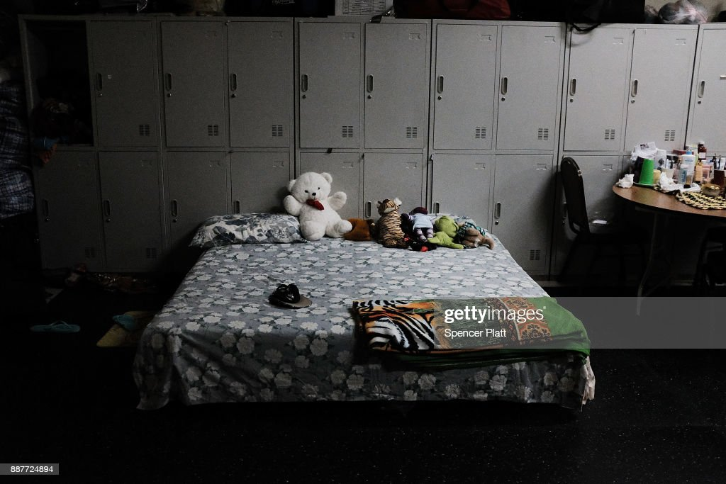 A bed sits inside a shelter for displaced residents from the island of Barbuda at a cricket stadium on December 7, 2017 in St John's, Antiqua. Barbuda, which covers only 62 square miles, was nearly leveled when Hurricane Irma made landfall with 185mph winds on the night of September 6. Only two days later, fearing Barbuda would be hit again by Hurricane Jose, the prime minister ordered an evacuation of all 1,800 residents of the island. Most are now still in shelters scattered around Barbuda's much larger sister island Antigua.