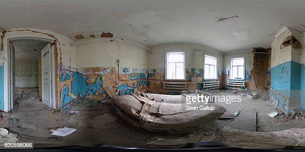 A bed stands in a room in an abandoned house on April 9 2016 in Zalissya Ukraine Zalissya once a village of several hundred households stands inside...