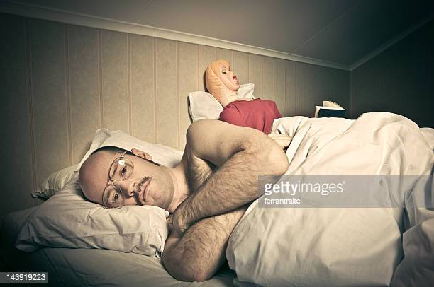 bed time routines - blow up doll stock pictures, royalty-free photos & images